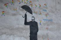 Гееборец под дождем из радужных человечков